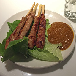 Pig-on-a-stick with peanut sauce