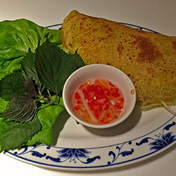 Bánh xèo, fried pancake with pork and lettuce wrap